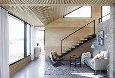 Stairway sitting niche. Summer House Skåtøy, by Filter Arkitekter As. Skåtøy, Norway. #paneling #stairs