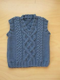 This Little Aran Vest pattern is available in sizes ranging from newborn to 24 months. This pullover vest features an allover cable pattern and v-neck.