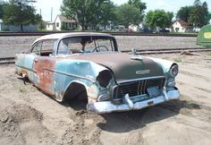 55 Chevy that just needs tires and a fender, maybe a battery?