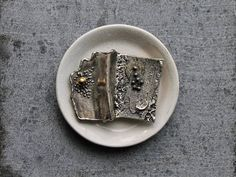 A lunar-inspired brooch by Montreal metalsmith, Gilles (Guy) Vidal. Modernist cast pewter alloy, the pin measures approximately 1 3/4 by 2 1/4 inches.  The freeform pin is in good vintage shape and is hallmarked on the reverse.  Comes tucked in a gift box.   More unique vintage jewelry found here: https://www.etsy.com/shop/tippleandsnack?section_id=5758730  (listing is for pin only)