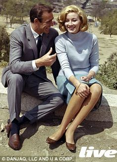 Sean Connery and Daniela Bianchi on the last day of filming From Russia With Love. Bad weather plagued the shoot, hence their good moods.