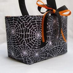 Cutest bag...(even thought I don't know how to sew)...she has 4 different sites listed with tutorials for the bag!!!
