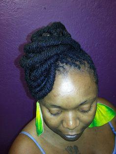 A loopy sisterlock updo by the talented hair stylist at Rare Essence hair salon in AZ