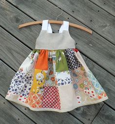 Sewing For Kids Clothes - It's a size months. But I believe back to school is for everyone. I made my own patchwork skirt layout instead of using the pattern's, however. Baby Patchwork Quilt, Patchwork Dress, Patchwork Patterns, Quilt Pattern, Little Dresses, Little Girl Dresses, Dress Girl, Sewing Clothes, Diy Clothes