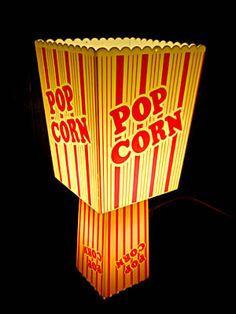 Popcorn light- I wonder if my Mom would like this. Popcorn Table Lamp: This table light has be transformed by re-useing 2 plastic popcorn containers. Perfect for your movie nights. There is a 15 watt bulb in the
