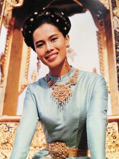 """Queen Sirikit in """"Borombiman"""" traditional Thai dress with ancient Thai-style rose-cut diamond jewelry."""