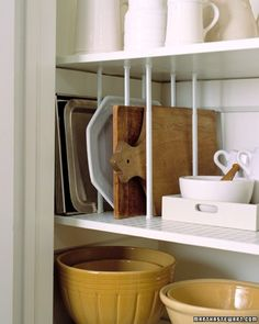 Store serving trays, platters, and cutting boards with tension curtain rods. Measure the vertical distance betweentwo cupboard shelves. Position appropriate-size rods between the shelves, as shown. Twist rods to tighten, so theirinner springs will keep them upright. Use two rods on both sides of each item, spacing them according to thedimensions of individual pieces.