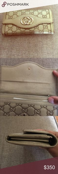 Gucci Continental Wallet Authentic Gucci Wallet Gold color A pen mark on it other than that good condition Gucci Bags Wallets