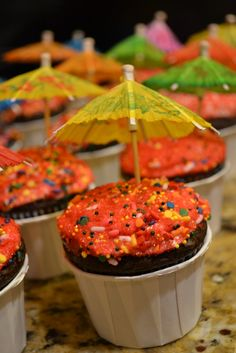Who said tiny umbrellas were only for drinks? Add some flair to your already adorable cupcakes for a more festive look.   #Margaritaville #ParrotHeadParties #DIY