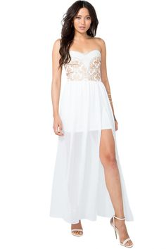A dramatic maxi dress featuring a gorgeous gold-toned damask bodice with bubbly faux pearl embellishments and a flowy chiffon train. Padded sweetheart bust. Strapless. Elasticized back. Defined waist. Finished hi-lo hem. $37.90