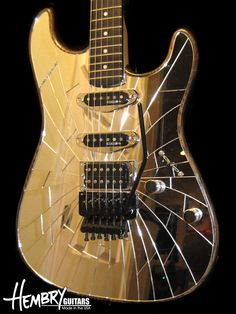 wow ... Ash body, Inlayed plexi mirror, Maple neck, Ebony fretboard, Kinman singles, Suhr humbucker, Push/pull series/parallel, Original Floyd Rose Black hardware Black stain