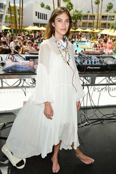 """Best dressed 15.04.15 : Alexa Chung in Chloé at Coachella in Palm Springs """"Alexa Chung's Chloé dress is a nice change from all the cut-off denim shorts at Coachella."""" – Dijana Savor, senior designer """"Alexa is Coachella chic in this divinely dreamy Chloé, perfectly matched with headphones and the requisite bare feet. Rock on!"""" – Sophie Tedmanson, deputy editor """"In the background of this image everyone seems to be looking right at her and I would be too. Bonus points for wearing this dress…"""