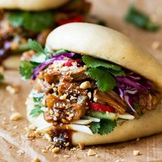 These fluffy Chinese bao buns are filled with salty-sweet marinated jackfruit, fresh veggies, herbs and roasted peanuts. Vegan.