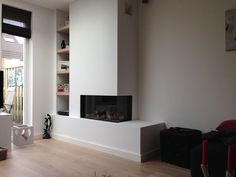 Modern living room with rectangle two sided corner fireplace