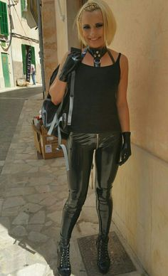 Blonde outdoors in casual latex pants choker harness