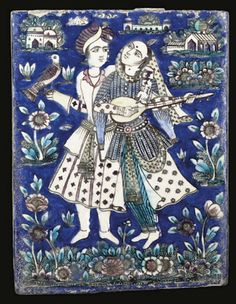 TWO QAJAR MOULDED POTTERY TILES, IRAN, 19TH CENTURY   Both of rectangular form, decorated under a clear glaze in blue, manganese and white, the first tile depicting a couple in a flowering landscape, the lady playing a musical instrument, the gentleman holding a falcon on his wrist - 6½ x 8½in (16.5 x 21.5cm); the second decorated with an archer riding a white horse before buildings and amongst flowers