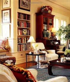 Gorgeous, cozy living room filled with books and antiques