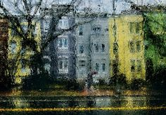 Looking more like an impressionist painting than a photograph, one can barely make out the pedestrian carrying a maroon umbrella while walking in the 600 block of E. Capitol St. NE, in this photo shot through a car window on a rainy afternoon.