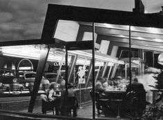 "This is a moody, noirish nighttime view of a Googie-style Biff's Coffee Shop in Los Angeles, photographed in 1950 by Douglas Honnold. W. W. ""Tiny"" Naylor started the Biff's coffee shop chain (named for his son) in 1948, and the affiliated Tiny Naylor chain in 1957. Naylor died in 1959, and Paul Hultman bought five of the nine Los Angeles area Biff's in 1964."