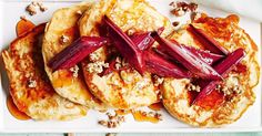Make an extra special breakfast with these gorgeous apple and buttermilk pancakes topped with roast rhubarb and crunchy granola.