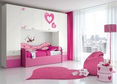 Pink and white girly bedroom.