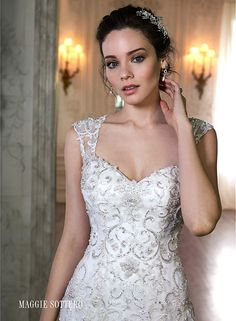 Tulle and lace fit and flare wedding dress with sweetheart neckline, detachable cap-sleeves and stunning keyhole back. Cheryl by Maggie Sottero.