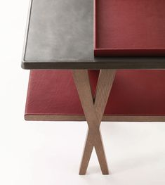 Designer: Antonio Citterio Console in greyed oak, stainless steel with surface patina and H red Clémence bull calf, Matières collection