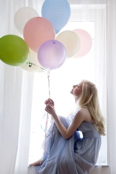 A simple-but-fresh take on balloon props--love the lighting, color selection, pose--overall, just a beautiful image.