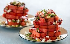 The bright colors, not to mention flavors, of watermelon and tomato slices stacked and topped with fresh mint make an eye-catching display. Take care to cut even slices of tomato and watermelon for an especially beautiful presentation.