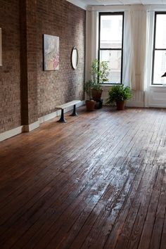 hardwood and exposed brick, how my 3 walls in my house are. All floors hardwood but I had to have some brick. Yoga Studio Design, Yoga Studio Decor, Home Design Decor, House Design, Home Decor, Design Ideas, Wooden Flooring, Hardwood Floors, Old Wood Floors
