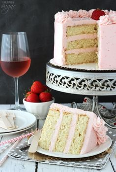 This Strawberry Moscato Layer Cake is made with layers of moscato cake and strawberry buttercream. It's moist, delicious, and it's a super fun way to drink your wine (and eat it too)! #layercake #strawberry #moscato #moscatocake #strawberrycake #strawberrylayercake #layercakerecipe