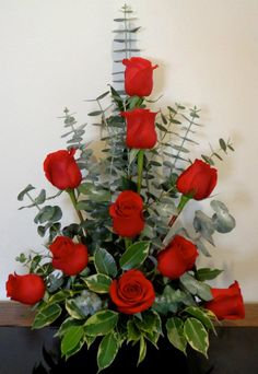 Beautiful long stemmed roses with Australian Eucalyptus foliage and ficus from the garden.