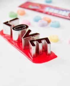 use airheads + mini cookie cutters to create edible lettering for sweets.