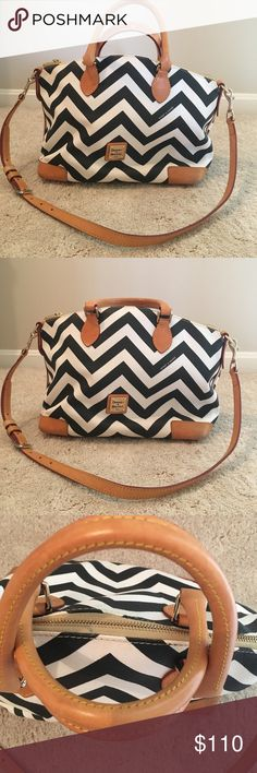 """Dooney & Bourke Chevron Pebble Grain Satchel Original $248 black & white chevron pattern on beautiful pebble grain textured leather. Red fabric lining- clean with no marks. Very gently used from a large purse collection and stored in dust bag. Will include dust bag. H 9.75"""" x W 7"""" x L 12"""" One inside zip pocket. 3 inside pockets incl. cell phone pocket. Adjustable, Detachable strap. Handle drop length 4"""". Strap length up to 35"""" on last hole Lined. Zipper closure. Dooney & Bourke Bags Satchels"""