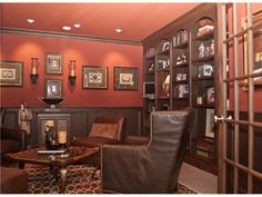 needs to be a little more country... but right idea for a cigar room. needs a moose head or bear head... some american pride and perfect!