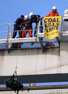 "Security guards stop a Greenepeace activists from flying a banner reading ""coal kills climate"" with a knife at the coal power station in Jepara, Central Java, Indonesia, 01, December, 2007. According to Greenpeace plans to build new coal power stations around the world is the single biggest threat to climate change ."