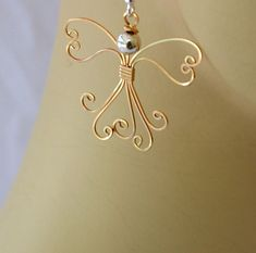 Wire wrapped Angel earrings. 14K gold filled handmade.. $35.00, via Etsy.