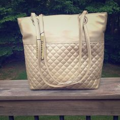 Gold quilted purse •Perfect condition, never used •Light gold metallic •Zippered top with multiple pockets •Feel free to ask any questions Bags Shoulder Bags