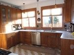 The remodeled kitchen with hickory cabnets, solid surface counter tops, and all stainless steel appliances.