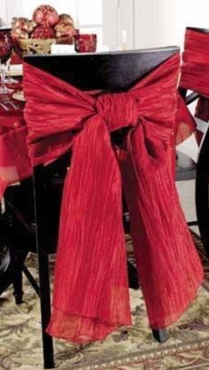 Take some red crepe paper and make flamboyant bows for festive table chairs.