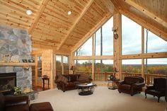 Living room - 10-inch pine half log hewn siding 8-inch vert corner 8-inch knotty pine on ceiling 6x6 beams