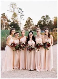 Bridesmaids in pale peach dresses autumn bouquets. Florals by Beehive Events. Image by Eric Kelley.
