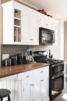 how to decorate a kitchen with black appliances and white cabinets. Ideas and updates