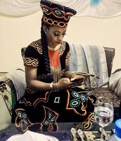 Beautiful Cameroon bride probably texting her groom #cameroon #toghu