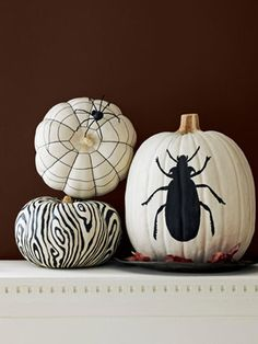 For each of these creepy crawly black-and-white designs, start by brushing the entire pumpkin with a coat of white flat acrylic craft paint and let dry for 20 minutes. To create these patterns or your own, use a black fine-tip paint pen for small details and black flat acrylic craft paint for larger designs. Then, let the pumpkins dry for 30 minutes.