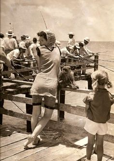 Women in bathing costume hanging out with a monkey in Port Aransas, TX, 1949