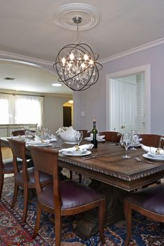 Get ready for the Holiday!! This modern contempo crystal chandelier lights up your dining room