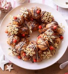 Profiteroles like you've never seen them before! With chocolate snowflakes and caramel hazelnut berries.