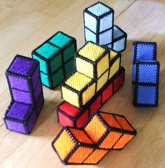 3D Tetris blocks from plastic canvas and yarn. I need to figure out how to make these before we have nerdlings.