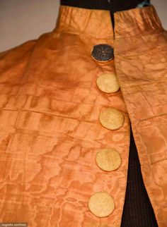 Detail front buttons, formal suit, 1760s. Peach moire faille, fabric covered disc buttons with silver foil and spangled embroidery, linen and blue silk lining.